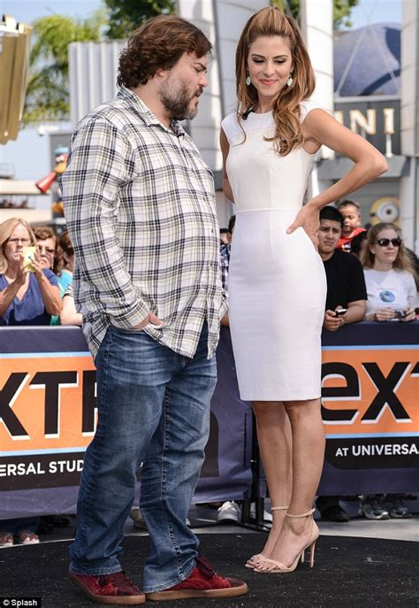 Jack Black gets hands-on as he massages Maria Menounos on
